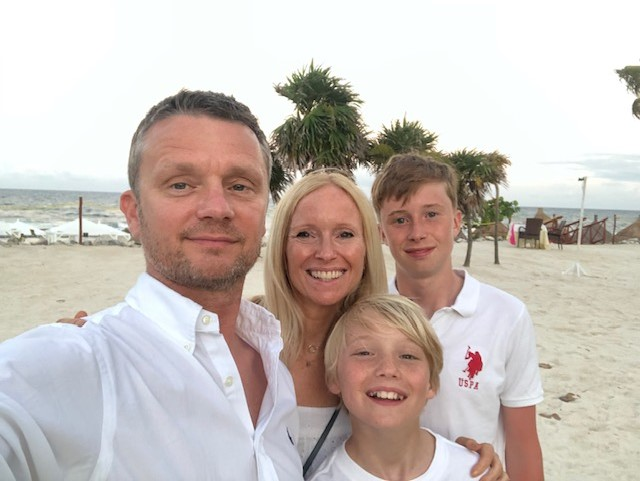 About me.  A picture of myself with my husband and 2 sons