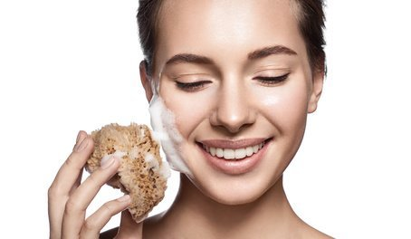 Lady with a foaming sponge to her face.  How important is cleansing?