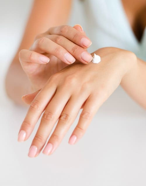 Lotion being applied onto a hand.  Anti-bacterial hand cream