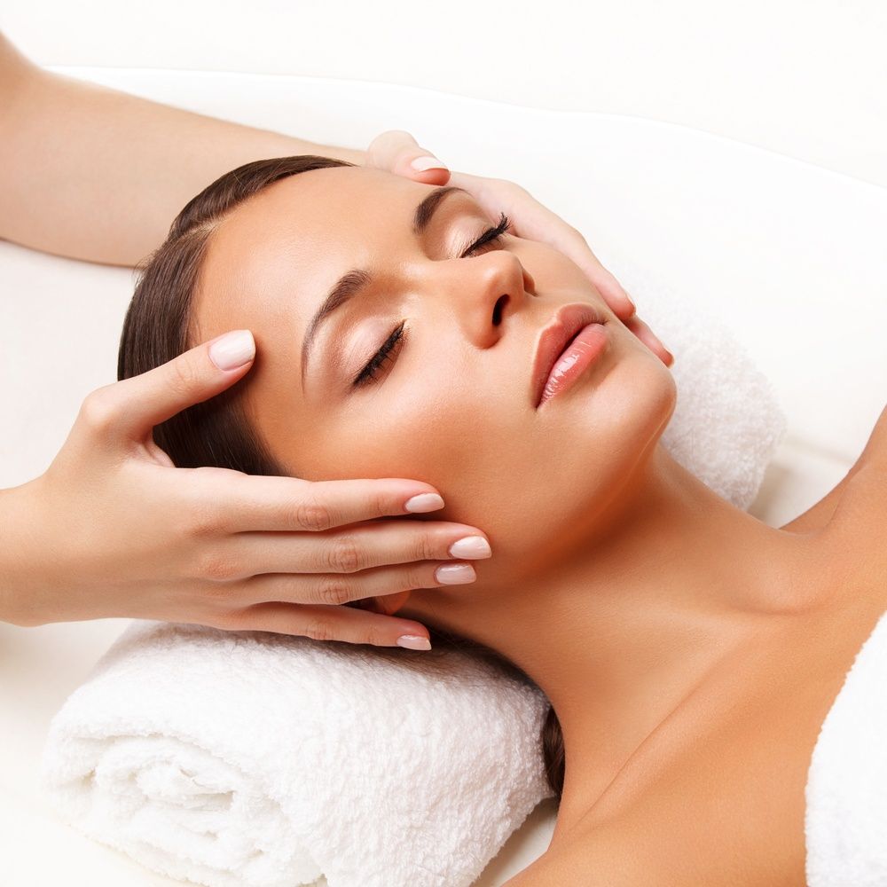 lady having facial massage - essential oils for dry skin