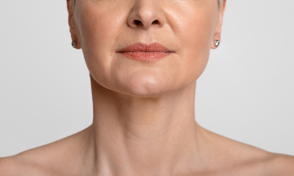 Mature lady showing lower half of the face and neck