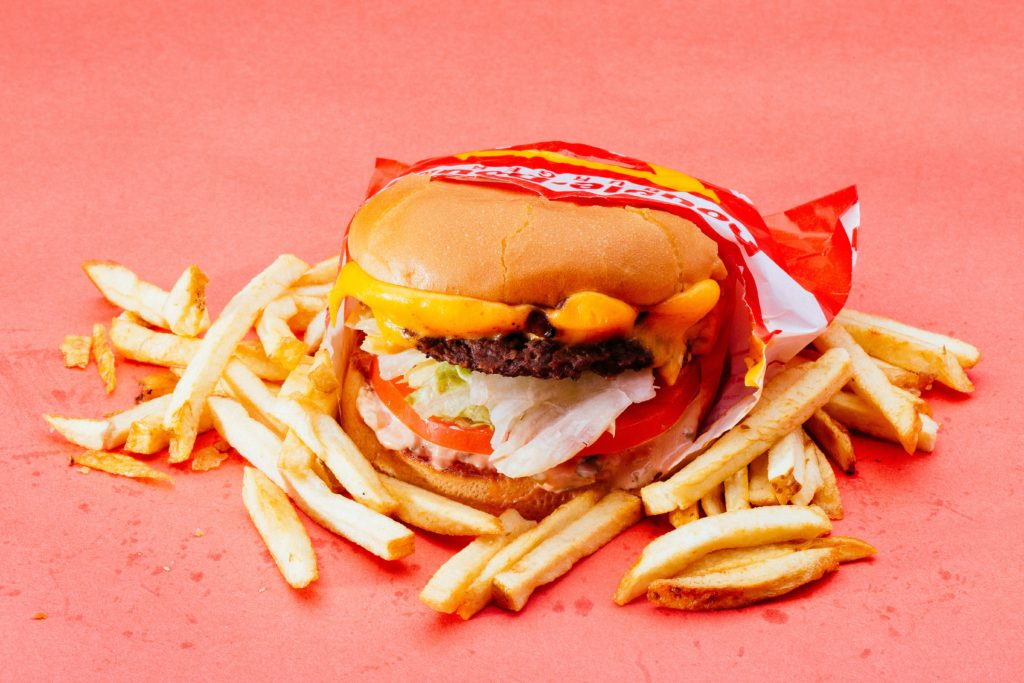 Photo by Isaac Taylor from Pexels.  Fast food - a poor diet causes skin to look dull and dry.