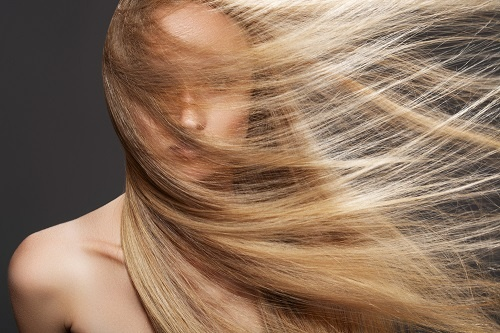 Women will beautiful long hair showing the best essential oils for the hair & scalp