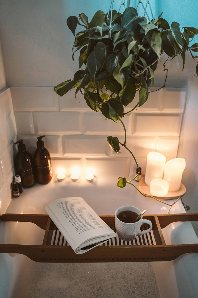 A spa-like bath with candles surrounding.  Self-care - how to live the good life.