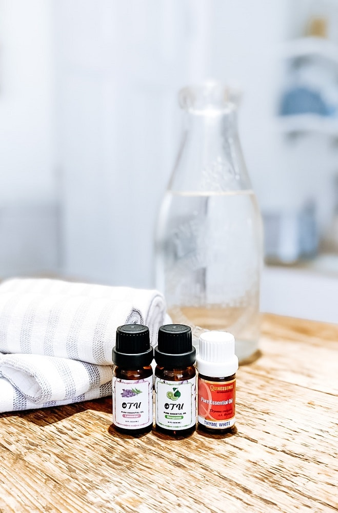 3 bottles of essential oils, muslin cloths and a carafe of water.  The best essential oils for athletes foot.