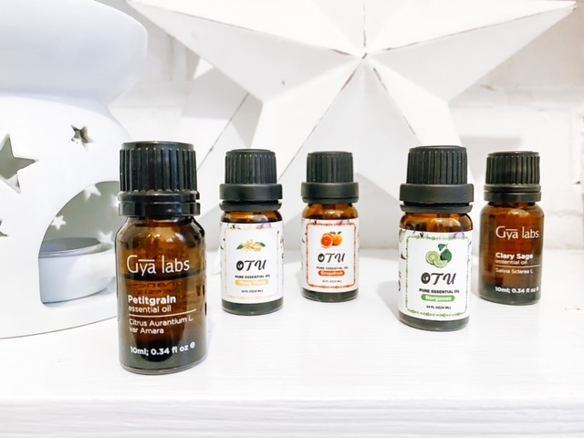 Essential oils for anxiety & panic - 8 oils to calm & relax Essential oils sitting on a shelf