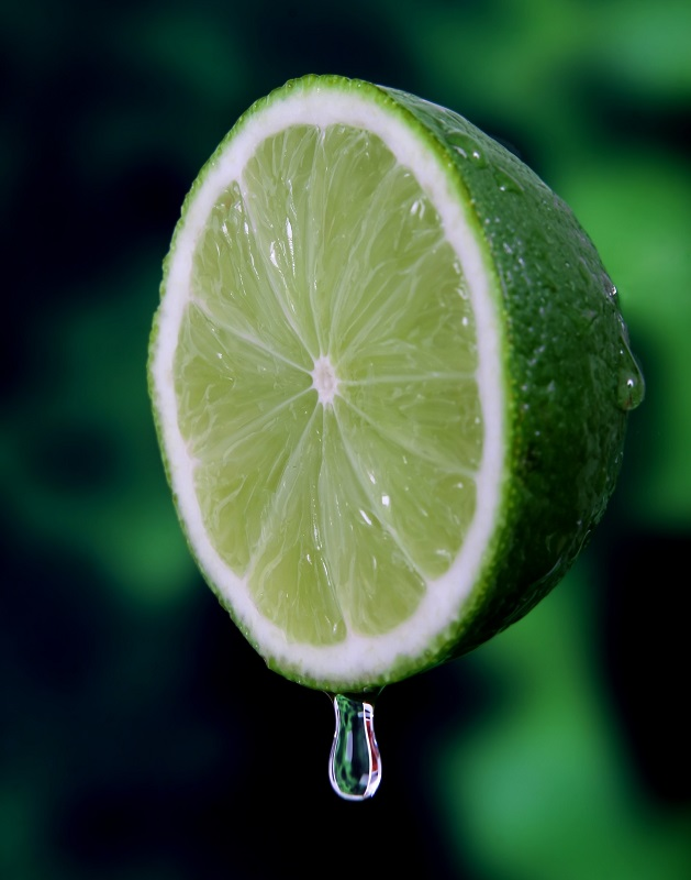 A half lime with a juice drop.  Lime essential oil blends