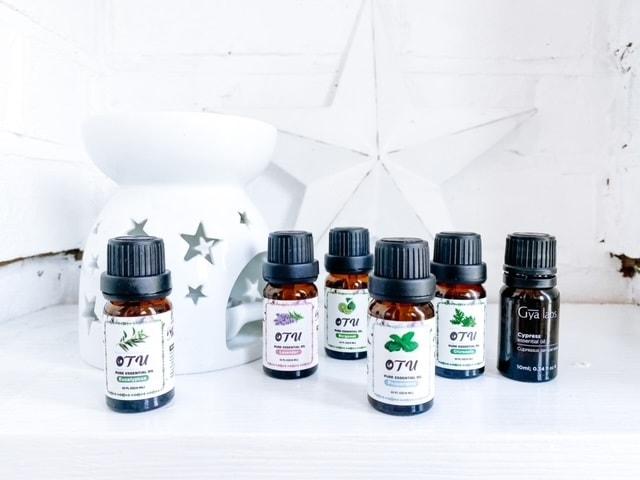 Essential oils on a shelf with a burner